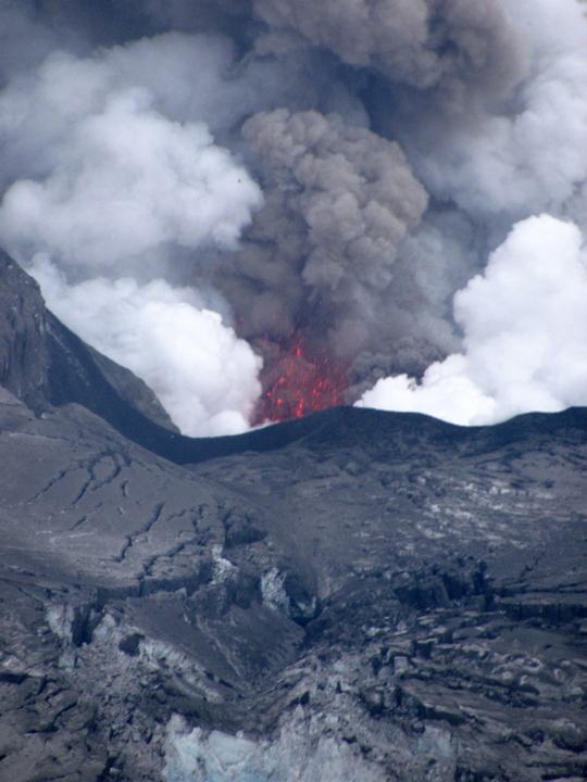 close up of magma, steam and ash